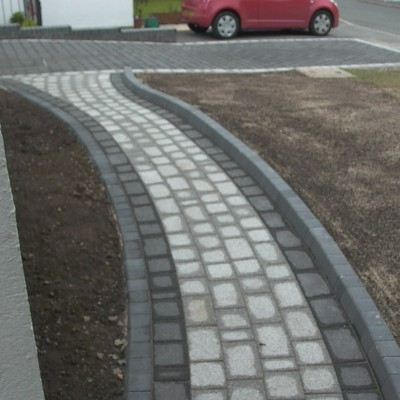 Pathway to drive, leading to fencing by Haverfordwest